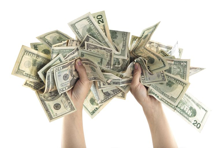 Image of hands holding cash.