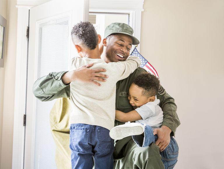 U.S. Military solider hugging his children.