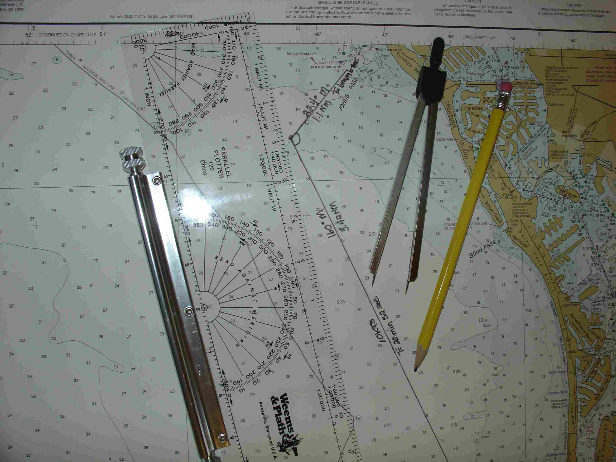 Two plotted courses using a parallel ruler and a set of dividers.