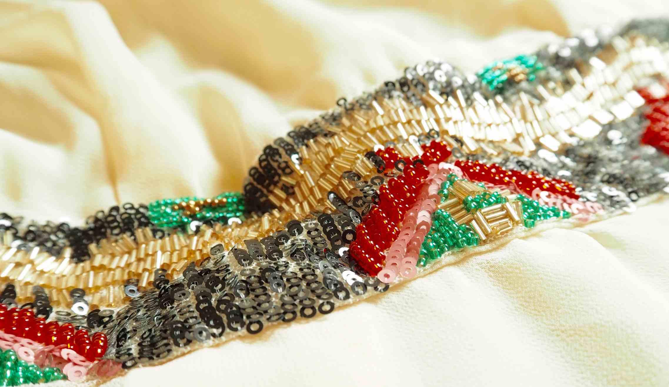 Close-Up Of Artwork On Dress