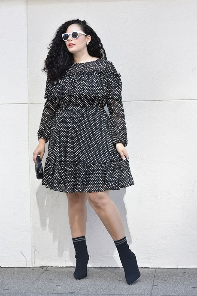 Woman in polka dot dress and ankle boots