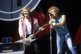 Foreigner guitarist and songwriter Mick Jones (l) and frontman Lou Gramm perform live at the Oakland Coliseum during the summer 1982.