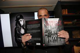 Nigel Barker holding up his book