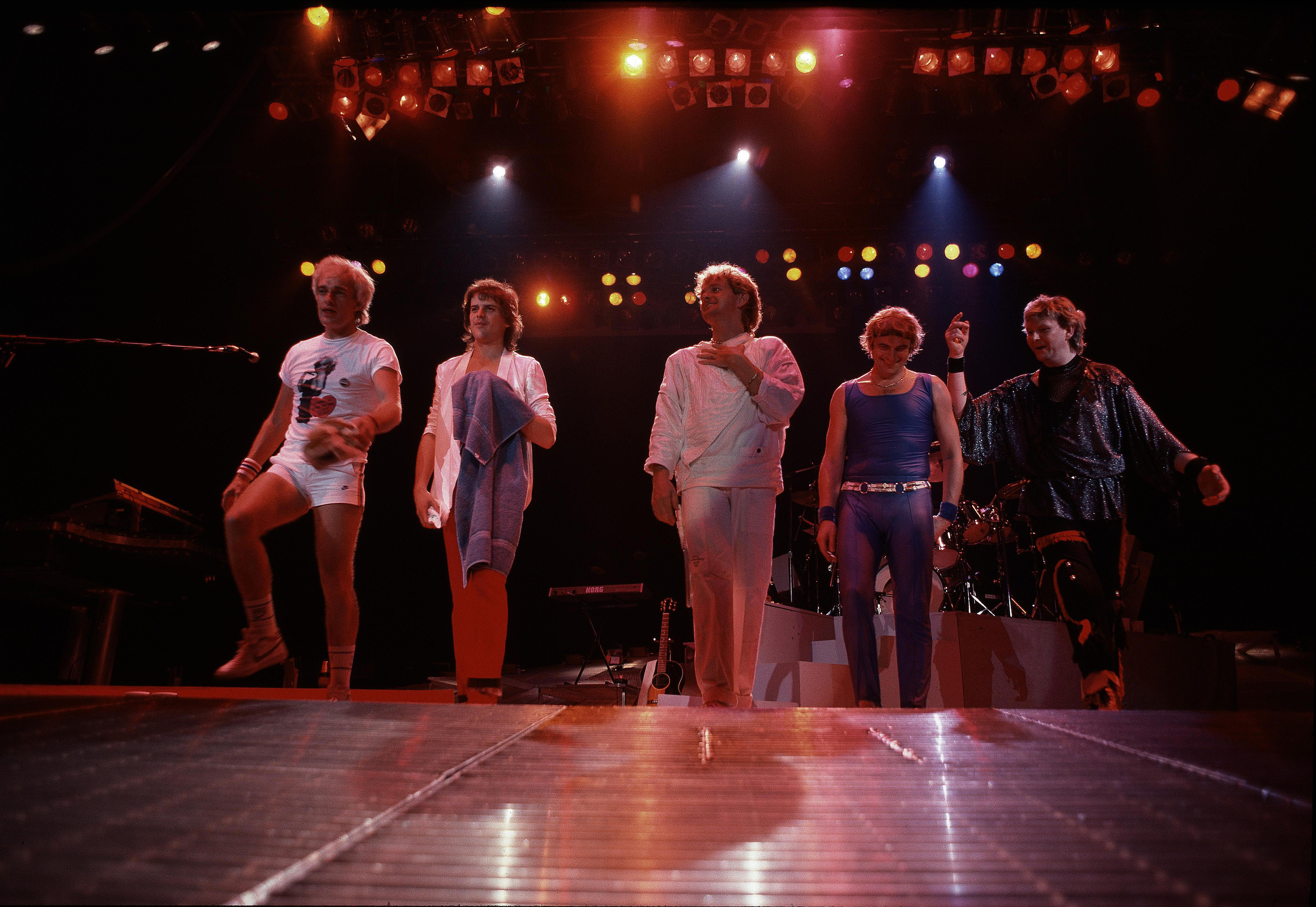The '80s lineup of English progressive rock group Yes featured shifting personnel and also delivered a more mainstream arena rock sound during the decade.