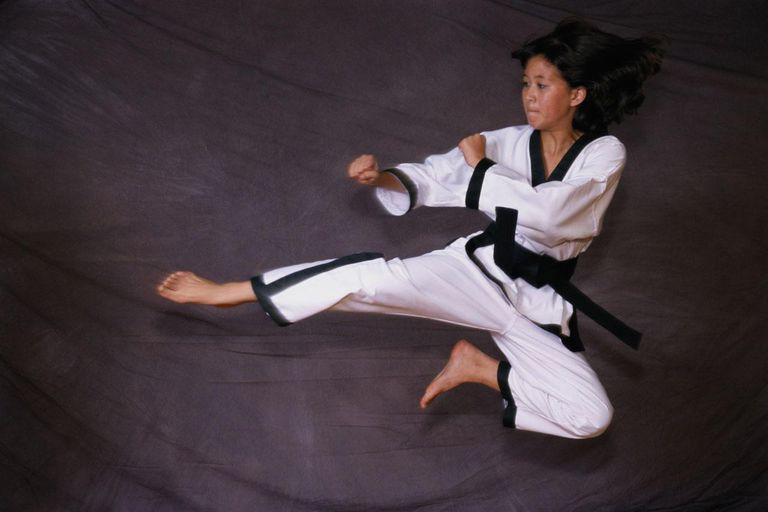 Tae Kwon Do Leap Kick - Woman practices martial arts