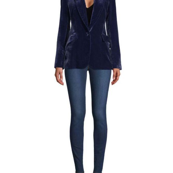 Woman wearing blue velvet blazer and skinny blue jeans