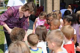 Children interacting with teacher