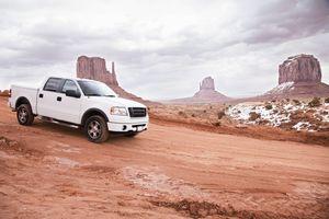USA, Utah, Monument Valley, Truck on desert road