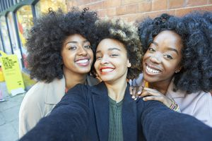 Group of black women with different hair textures - hair typing