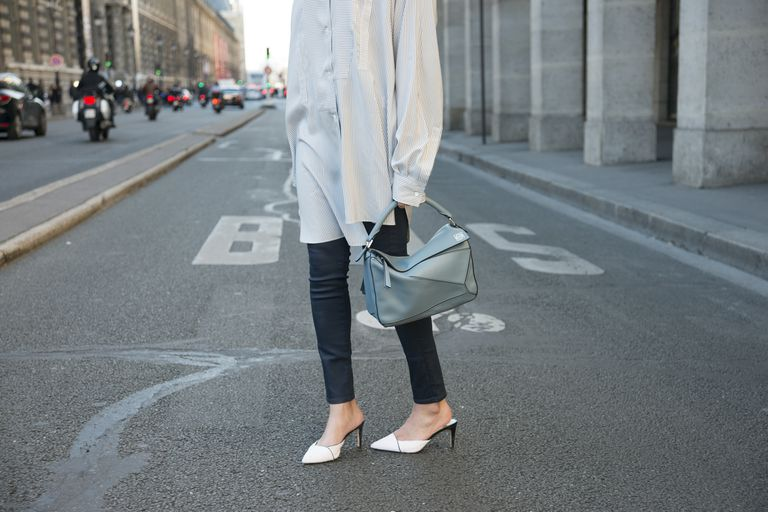 Woman wearing J Brand jeans and Sam Edelman shoes on city street