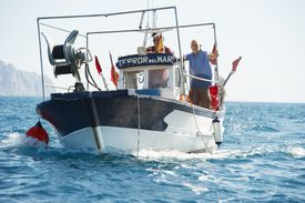 men on a fishing boat