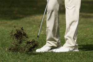 Golfer hits the ground and digs up a lot of turf for a chili dip