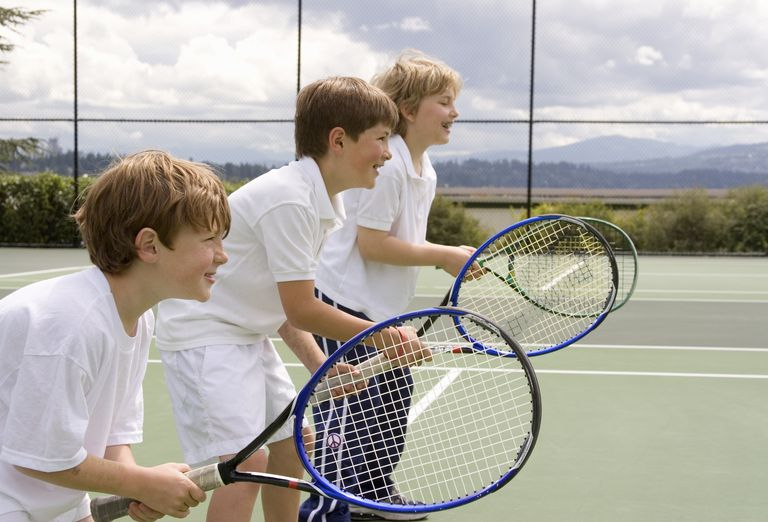 Young boys playing tennis