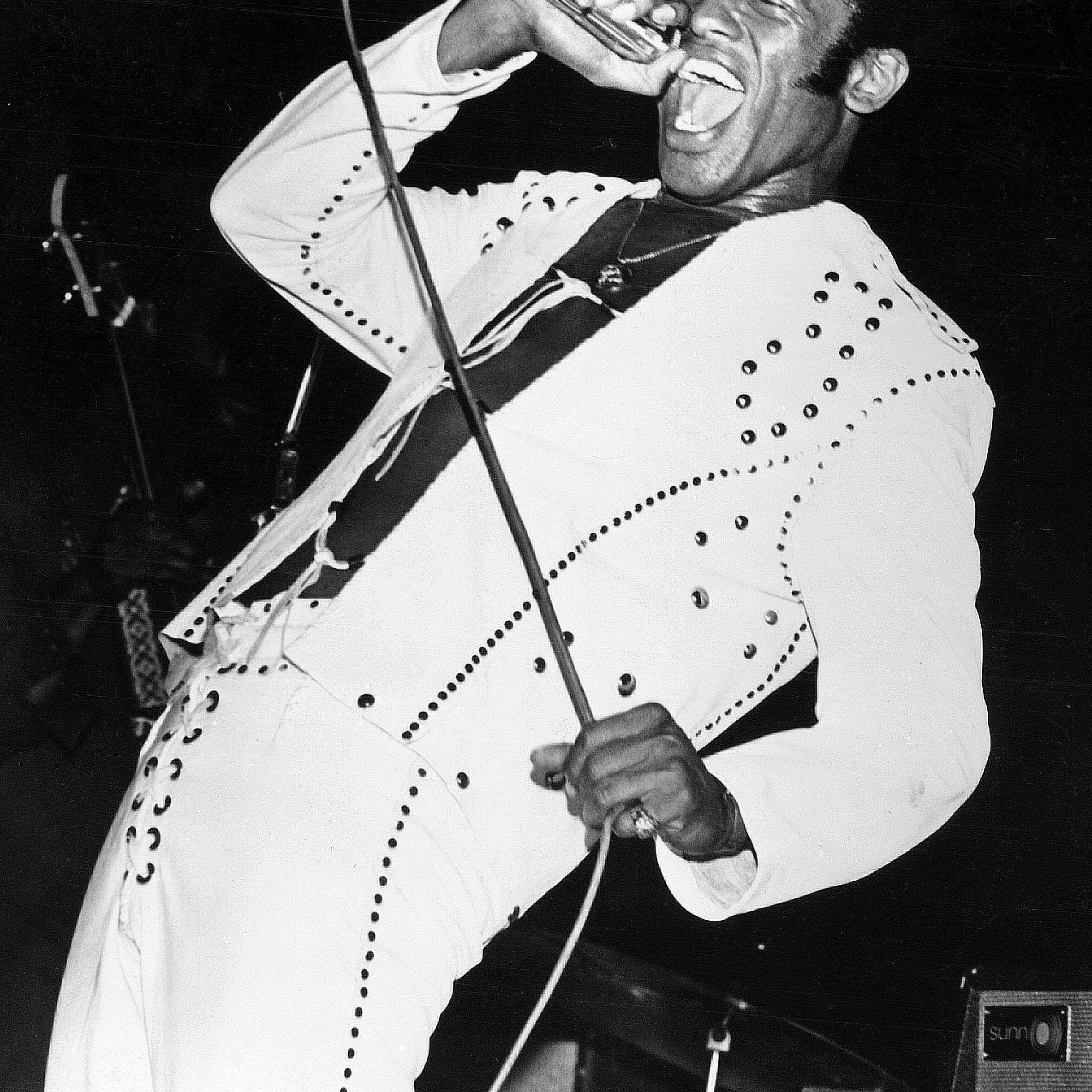 Bobby Womack sings during a performance