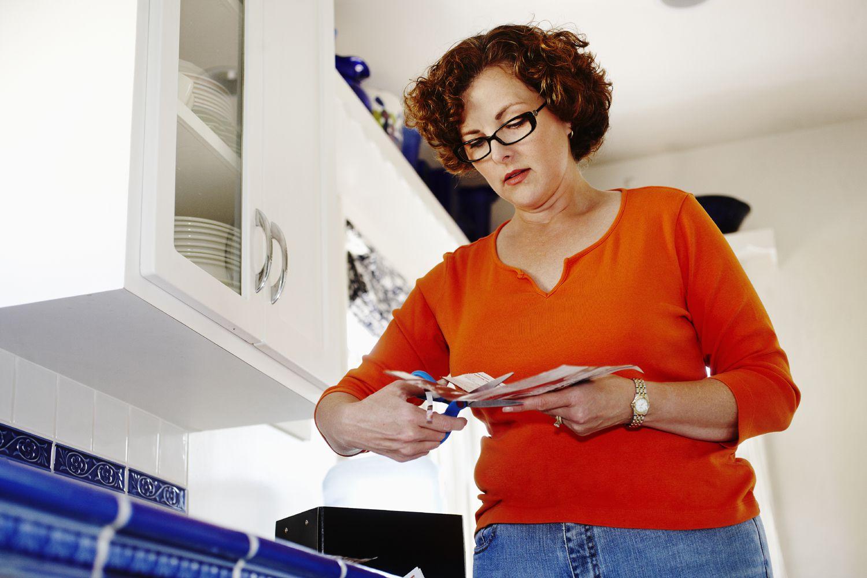 Woman cutting coupons.