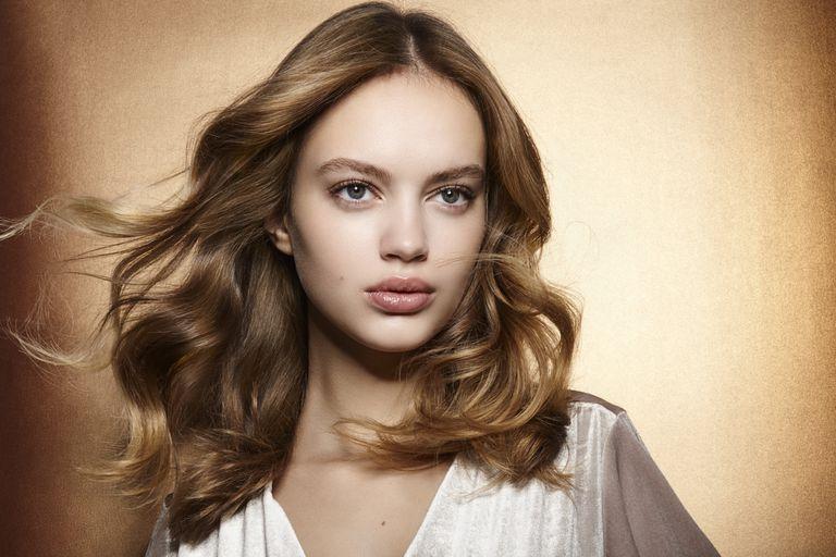 Brunette glamor model with windblown hair