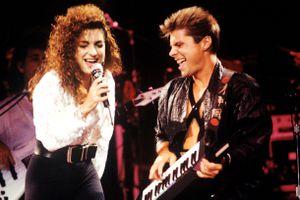 Gloria Estefan and keytarist Jim Trompeter onstage at a 1988 Miami Sound Machine performance