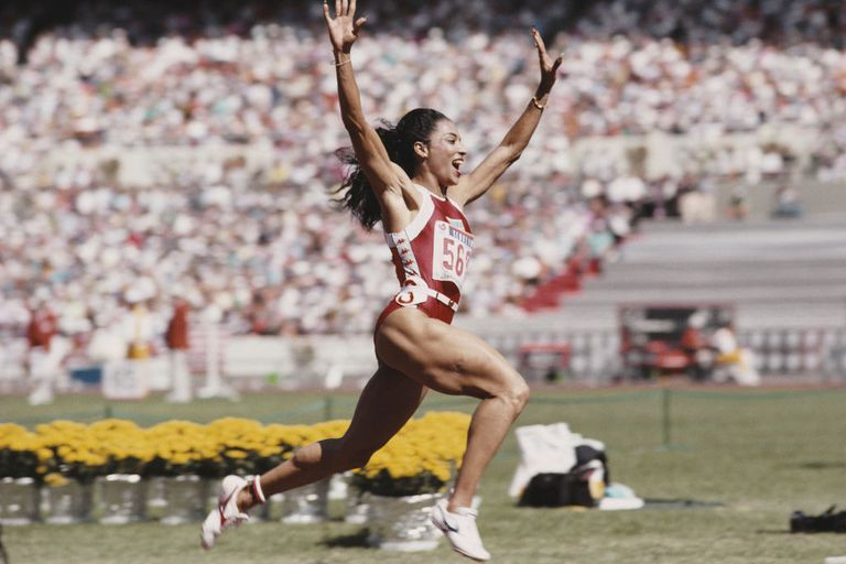 Florence Griffith-Joyner of the United States celebrates winning gold in the Women's 100 metres final event during the XXIV Summer Olympic Games