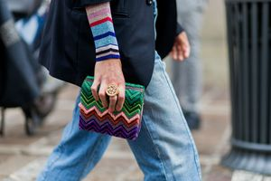 Street style Missoni clutch and jeans