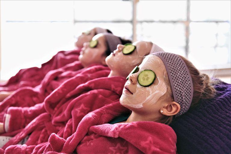 Young girls getting a facial