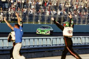 Driver Bobby Labonte wins the Ford 400 in 2003.