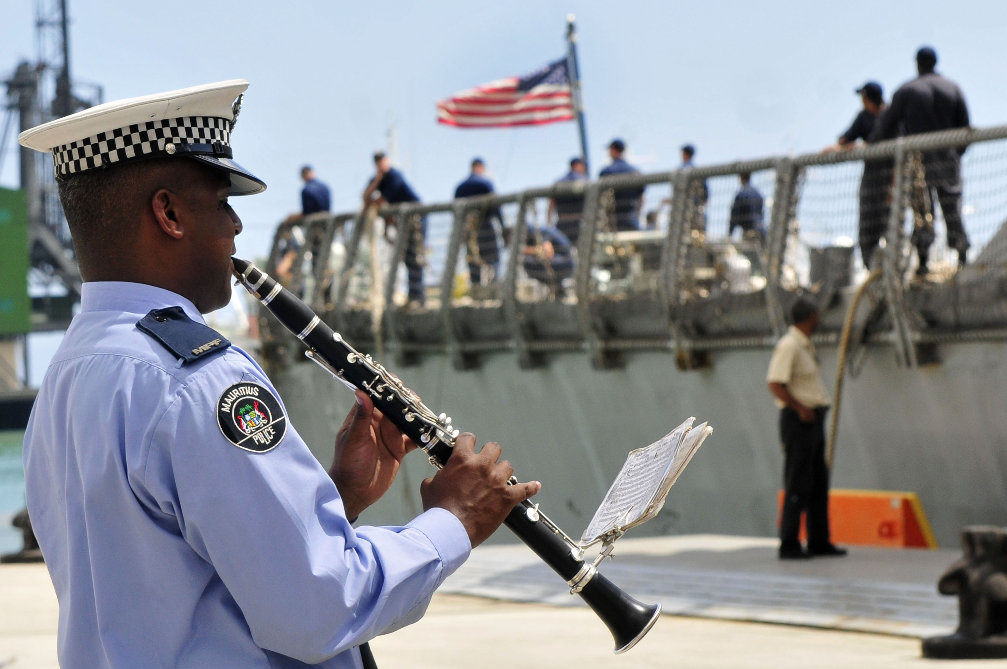 A member of the Mauritian Police Force Band plays the clarinet.