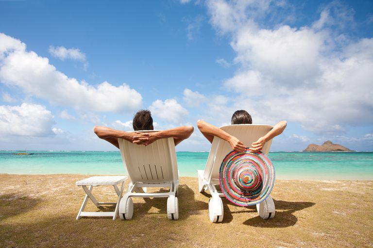 Couple relaxing on a beach in Hawaii