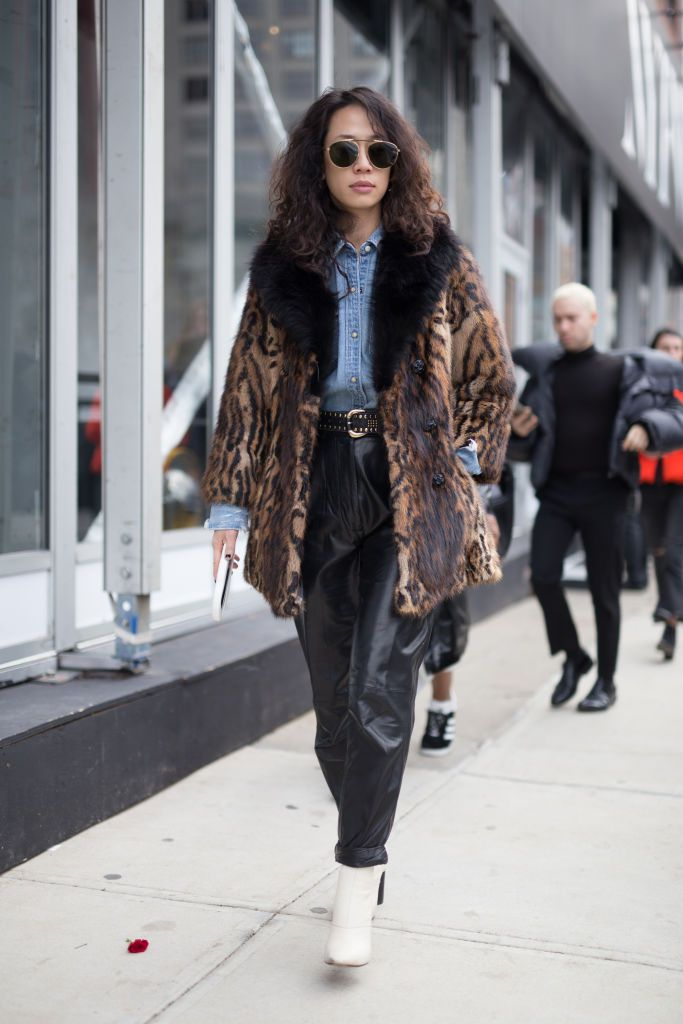 ec95733d1b8 Woman in leopard print coat and leather pants and white boots