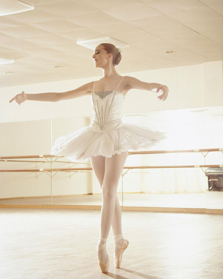 Young woman practicing ballet in dance studio