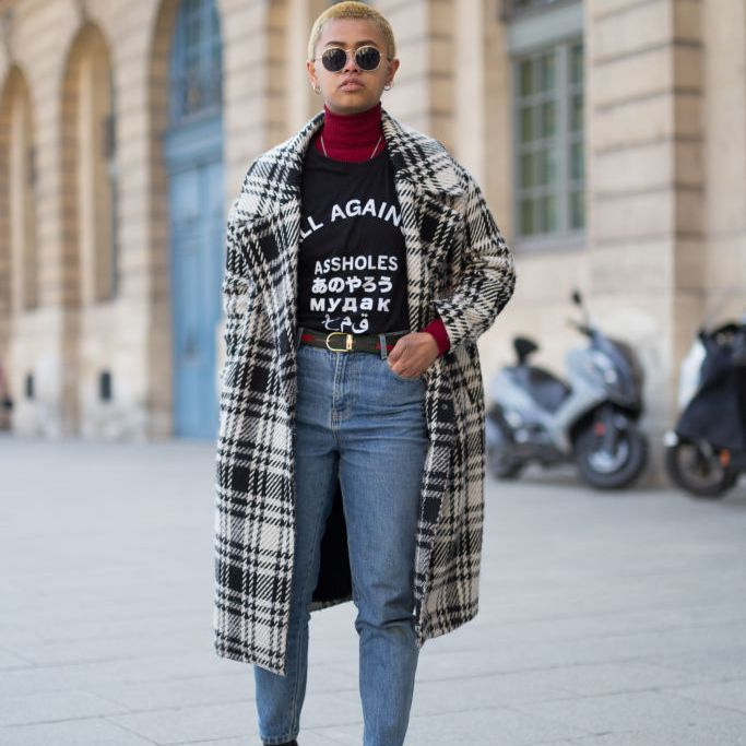 Street style fashion woman in plaid coat and jeans