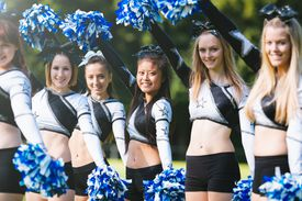 Cheerleader group with pom-pom together