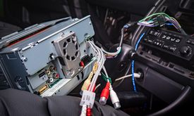 Back of car stereo with wires being connected to car