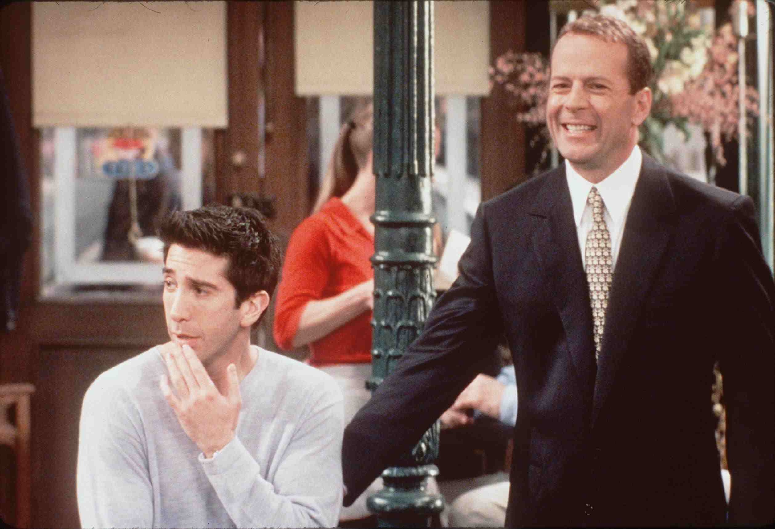 Bruce Willis next to David Schwimmer on the set of Friends.