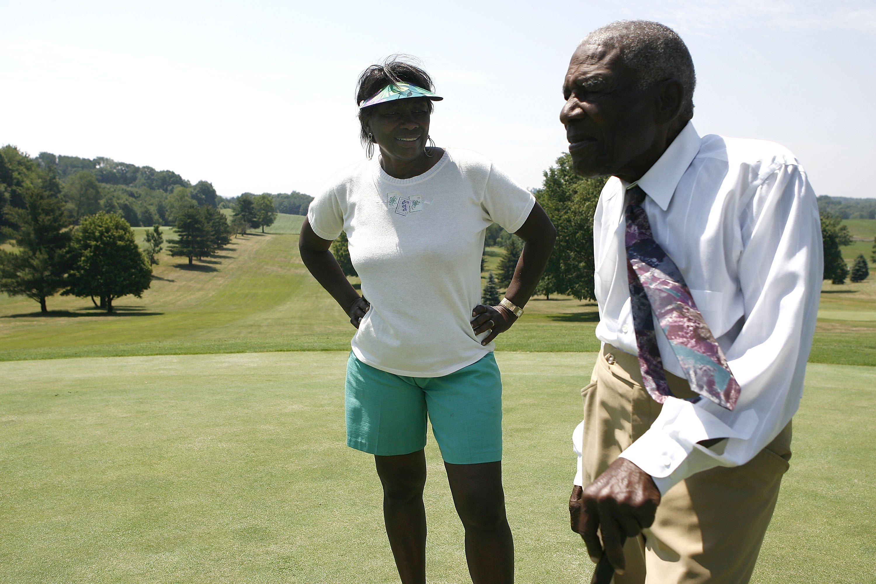 Daughter and father Renee Powell and Bill Powell as their family owned golf course Clearview Golf Club in 2009.