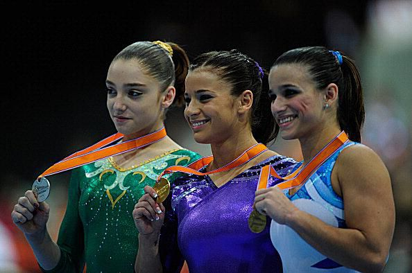 Gymnasts Alicia Sacramone, Aliya Mustafina, Jade Barbosa with their vault medals at the 2010 worlds