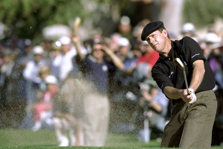 Payne Stewart blasts out of a bunker at the 1999 Bob Hope Chrysler Classic tournament.