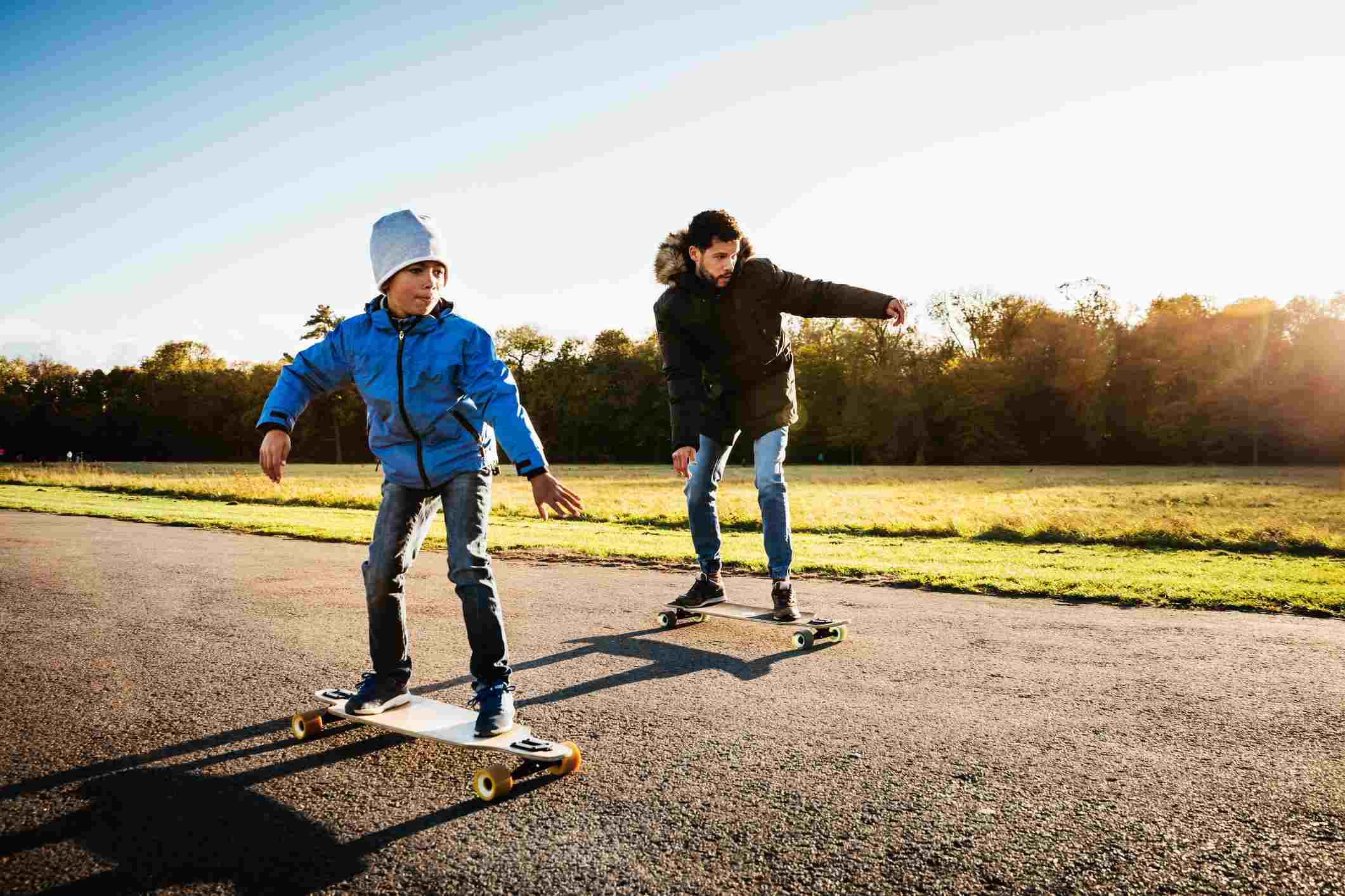Single Dad Long Boarding With His Son