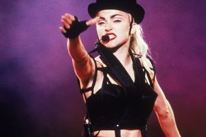 Madona performing with hat on