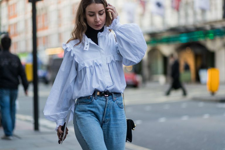 Women wearing pleated blouse and blue jeans