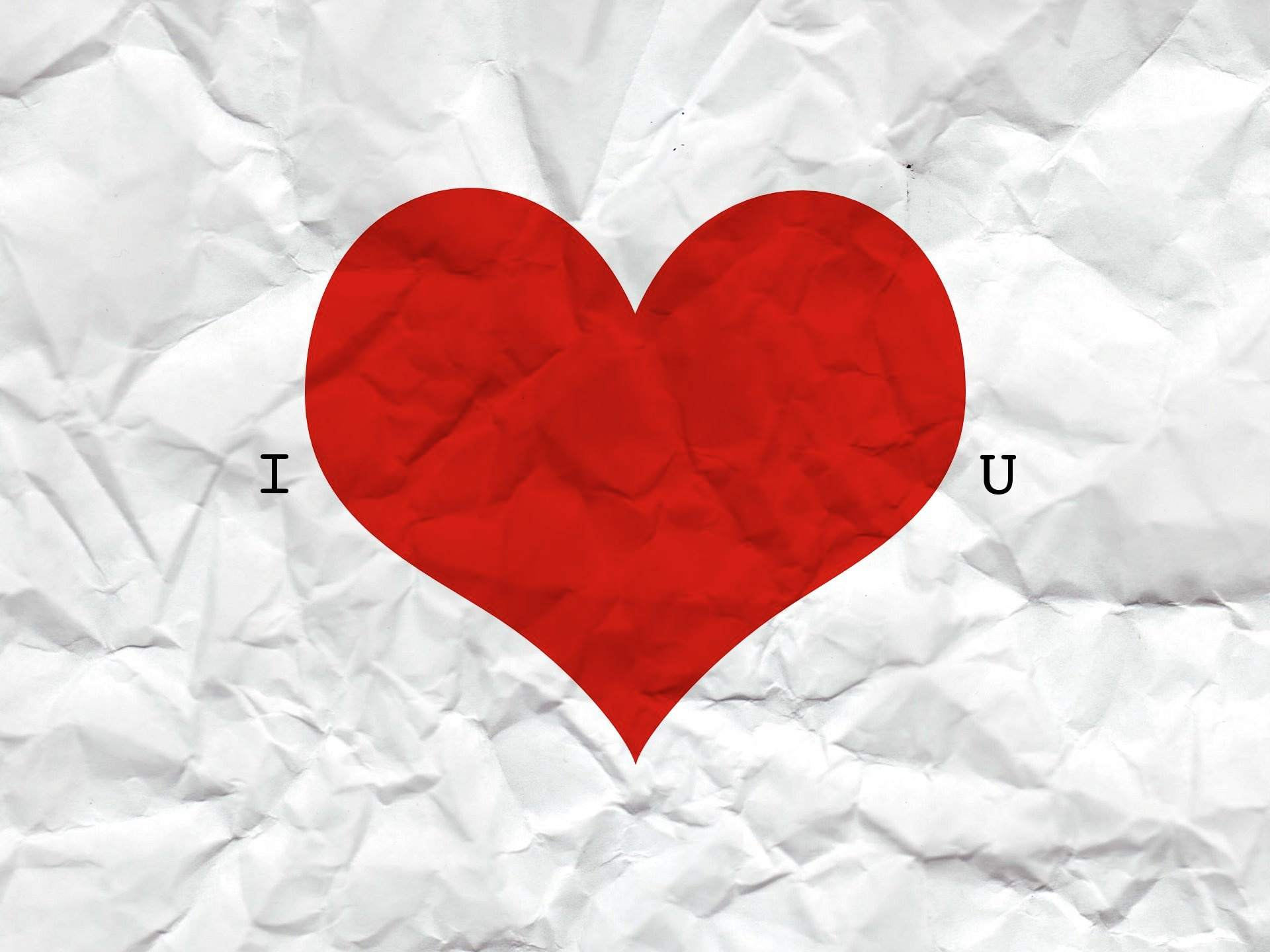 A crumpled piece of paper that says I Love You.