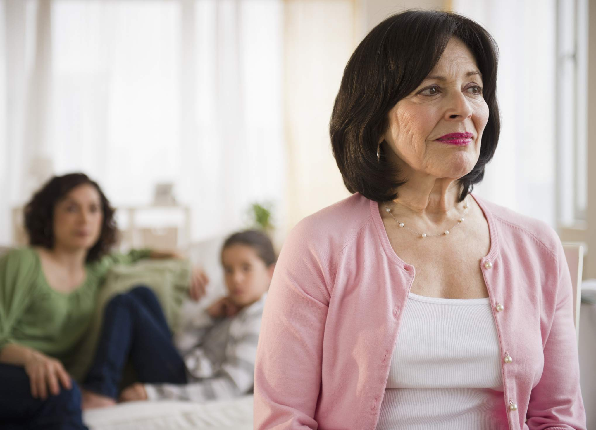 Hispanic grandmother ponders how to say no.