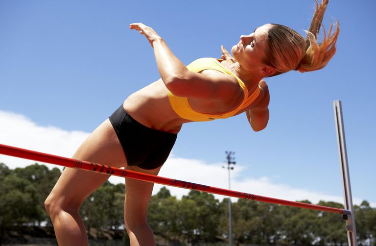 Female athlete doing high jump