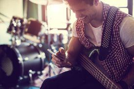 Man using a phone in a music studio
