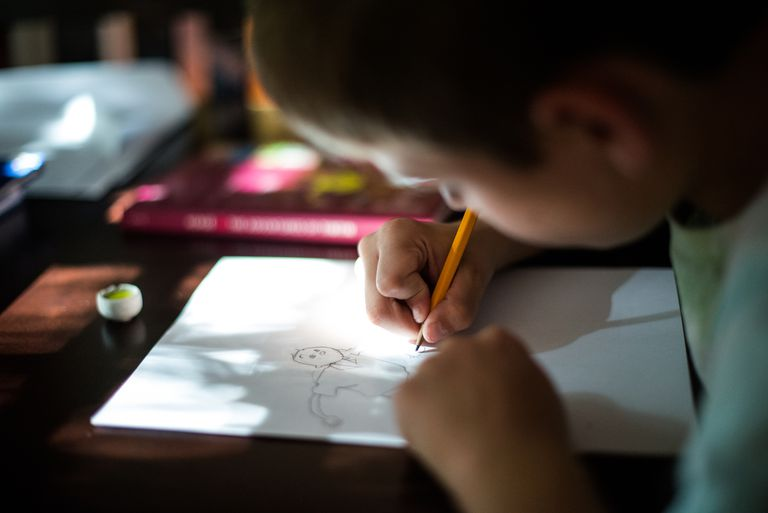 Boy Drawing Cartoon Person