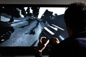 A gamer plays Grand Theft Auto IV on PlayStation 3