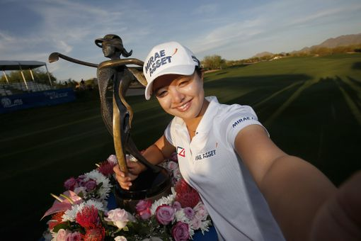 Sei Young Kim of South Korea poses for a selfie with the trophy after winning the LPGA JTBC Founders Cup at Wildfire Golf Club on March 20, 2016 in Phoenix, Arizona.