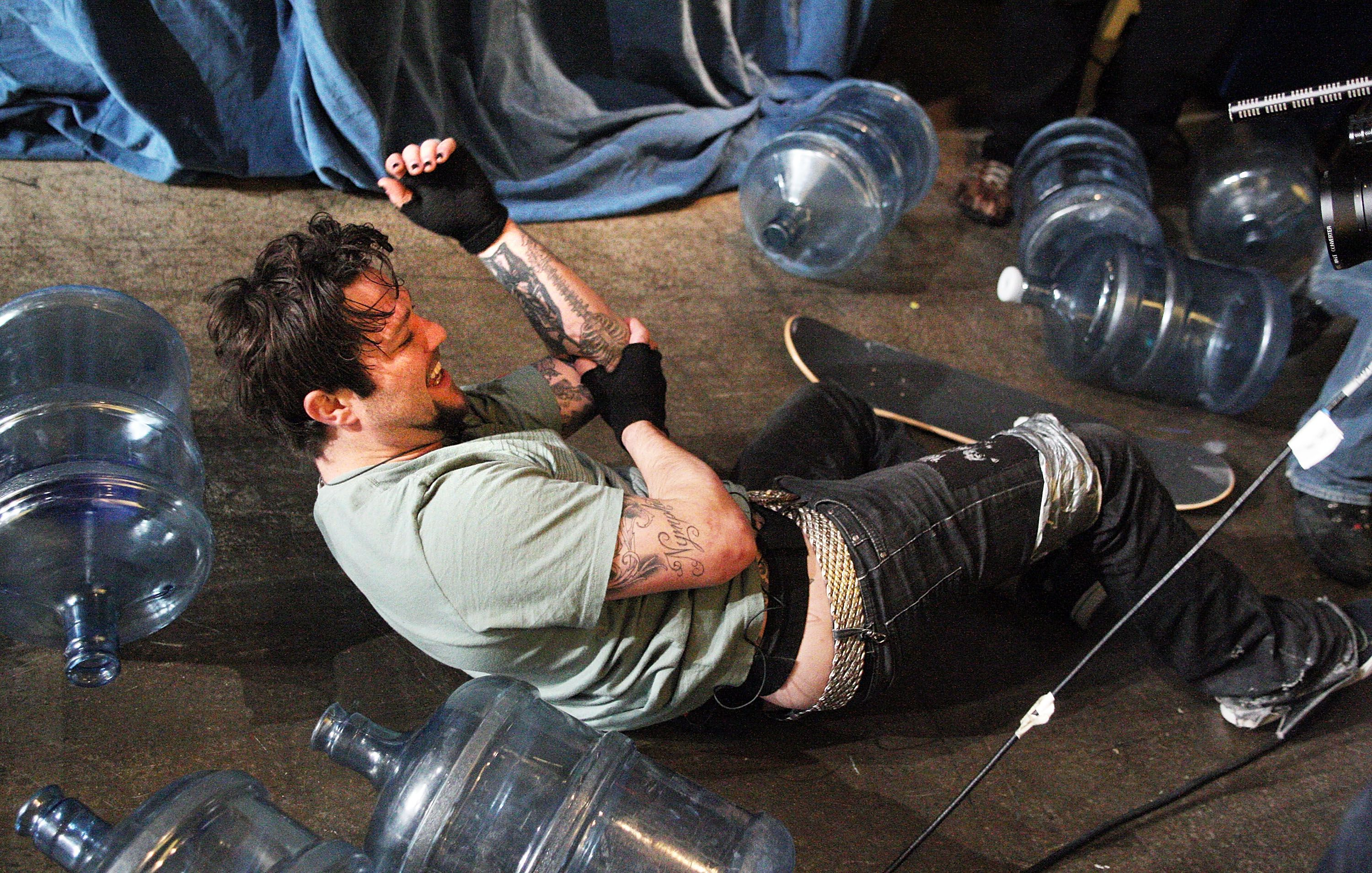 Bam Margera getting injured in a skateboarding fall without safety equipment