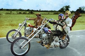 Actors Dennis Hopper, Peter Fonda, and Jack Nicholson ride motorcycles in 'Easy Rider' (1969)