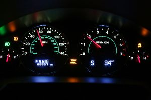 Dashboard view of colorful gauges on an automobile