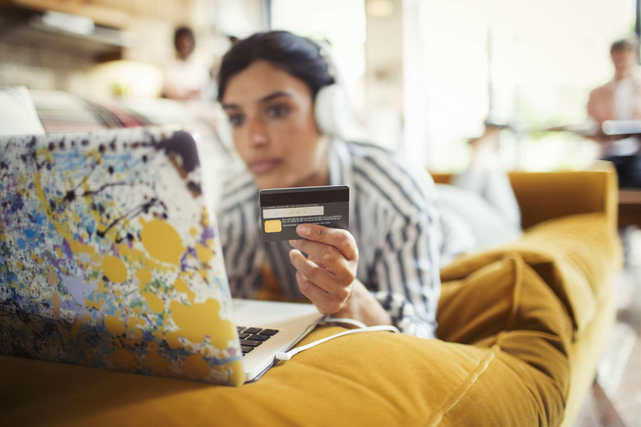 Woman shopping online for cashback